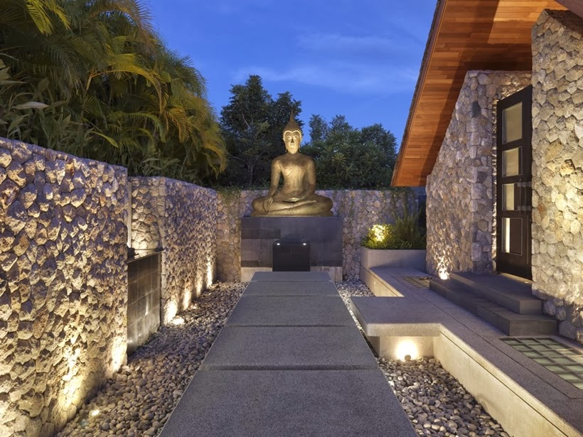 Statue of Buddha in Villa with contemporary Asian design