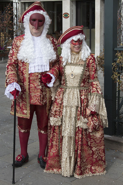 couple in red costume, Venice