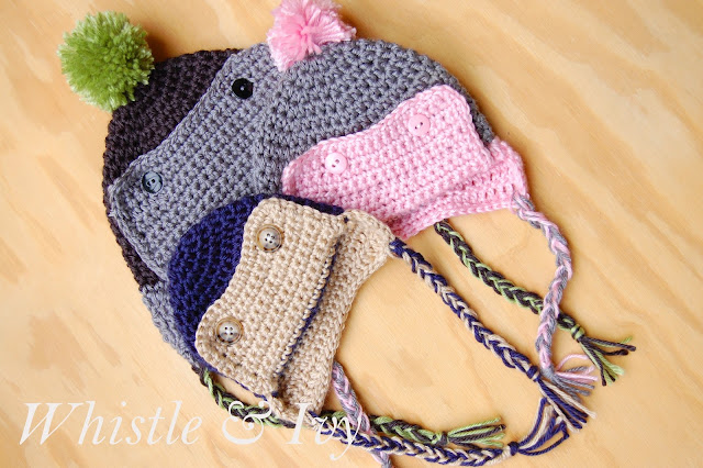 Free Crochet Pattern: Baby Button Eskimo Hat. Perfect for a boy or girl! So warm and cozy. {Pattern by Whistle and Ivy}