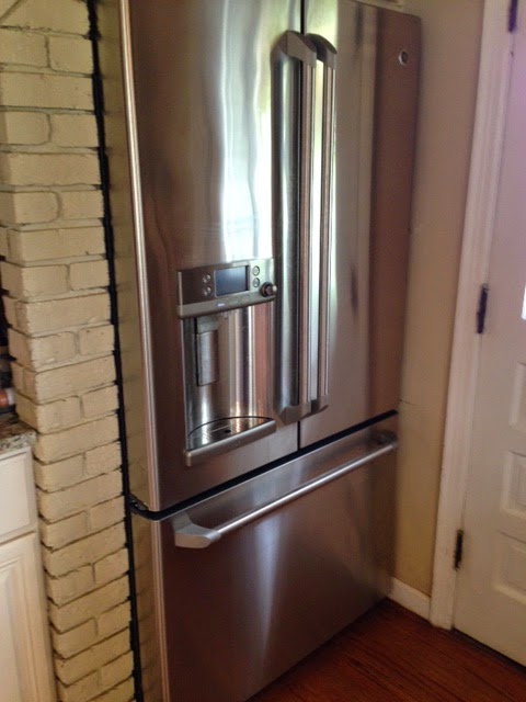 armoire style refrigerator with freezer drawer