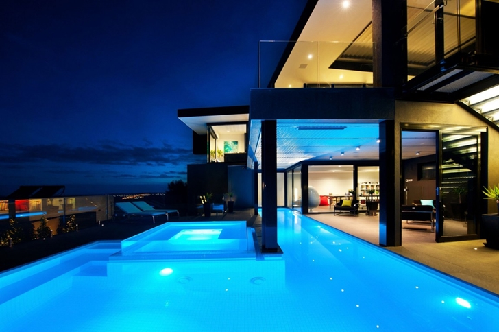 Blue swimming pool lighting in Dream home in black and blue