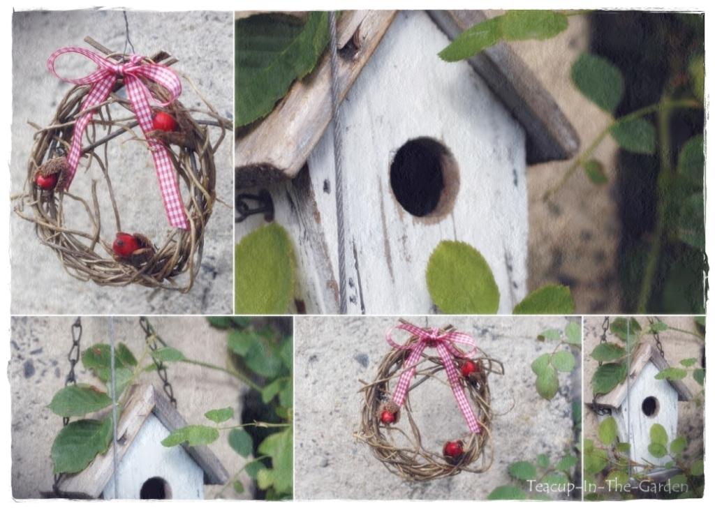 Teacup in the garden a bird house and a wreath of rose for Herbstliche gartendeko