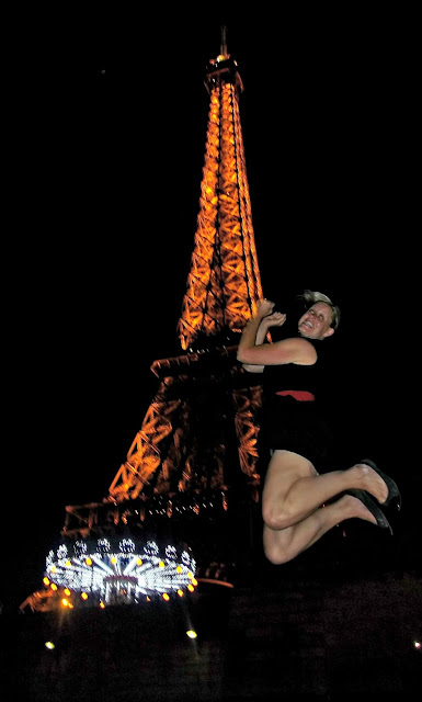 Take a leap at night in front of the Effiel Tower