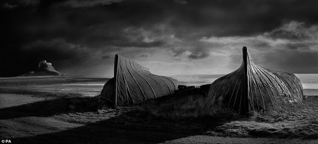 Boats on the coast of Lindisfarne, Northumberland, England
