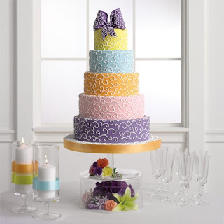 5 tier pastel fondant wedding cake with scrolls and bow
