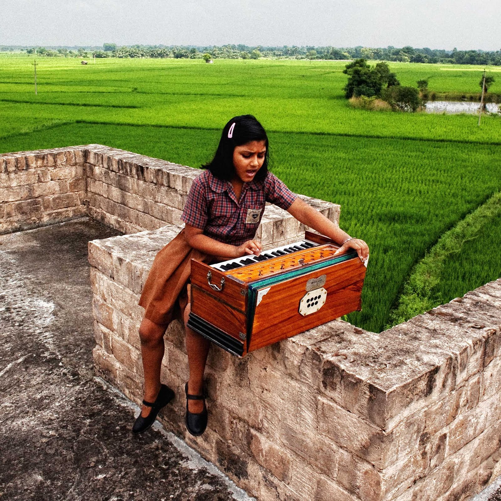 School girl with harmonium