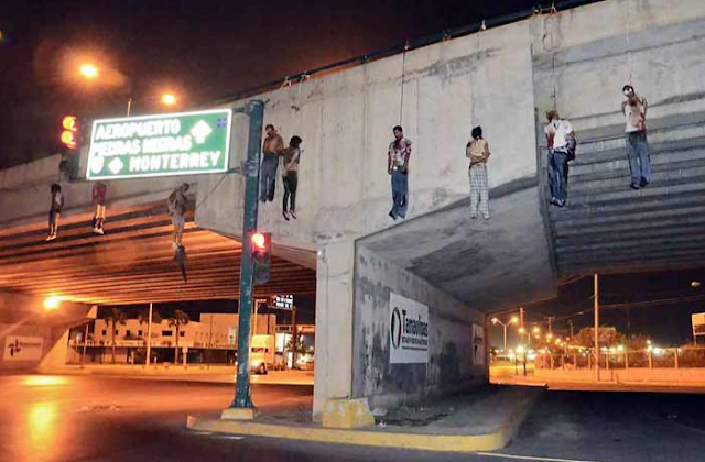 four women and five men were found hanging off a bridge in the Mexican ...