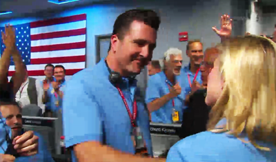 Curiosity MSL lands on Mars. Entry, Descent and Landing (EDL) team in blue shirts. Adam Stelzner congratulates EDL colleagues. 6 August 2012. NASA/JPL.