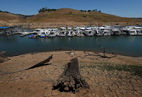 Low water levels caused by drought at the New Melones Lake reservoir in central California (Credit: Mark Ralston/Agence France-Presse — Getty Images) Click to Enlarge.