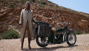 James Coburn as IRA dynamite expert and revolutionary John H. Mallory, bike punctured scene, John's face covered, Directed by Sergio Leone