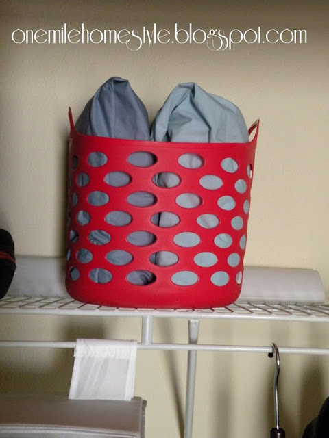 Storing kids bedding in baskets in a closet