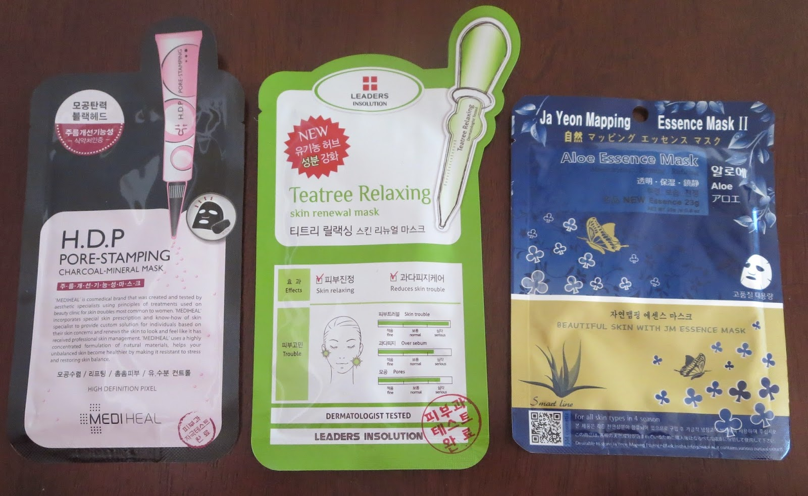 a picture of Korean Sheet Masks (Mediheal Pore-Stamping Charcoal, The Leaders Teatree Relaxing Skin Renewal, Ja Yeon Mapping Aloe Essence)