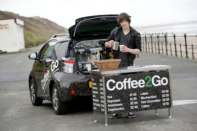 Jason Bowes and his Coffee2Go Scion iQ. Photo credit: http://blog.toyota.co.uk/coffeeiq