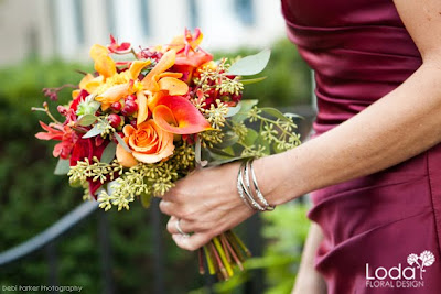 fall bouquet, mango calla lilies, orange roses, orange mokara orchids, james stori orchids, seeded eculyptus