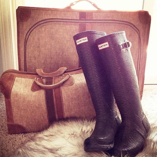hunter wellies boots and vintage luggage