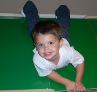 My toddler crawling on the table in his Denizen blue jeans