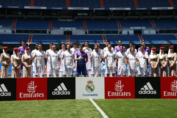 The Real Madrid first team squad pose with next season's new adidas kit
