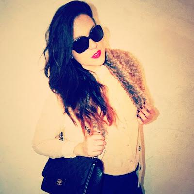 Chanel jumbo with Prada sunglasses and fur vest