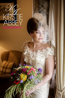Kimberley wearing a lace vintage wedding dress with a customised veil and avant garde hairstyle