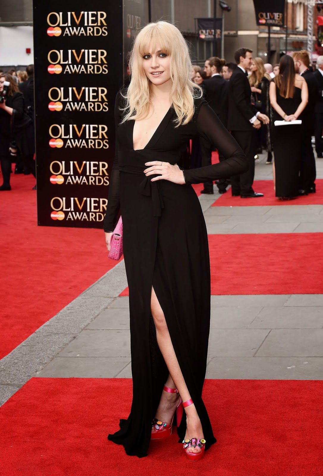 Pixie Lott shows off skin in a plunging dress at the 2015 Olivier Awards in London