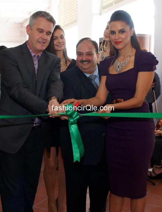 Neha Dhupia in a black formal dress cutting the ribbon  -  Neha Dhupia @ 'Leading Italian Jewels' by Gitanjali in Singapore