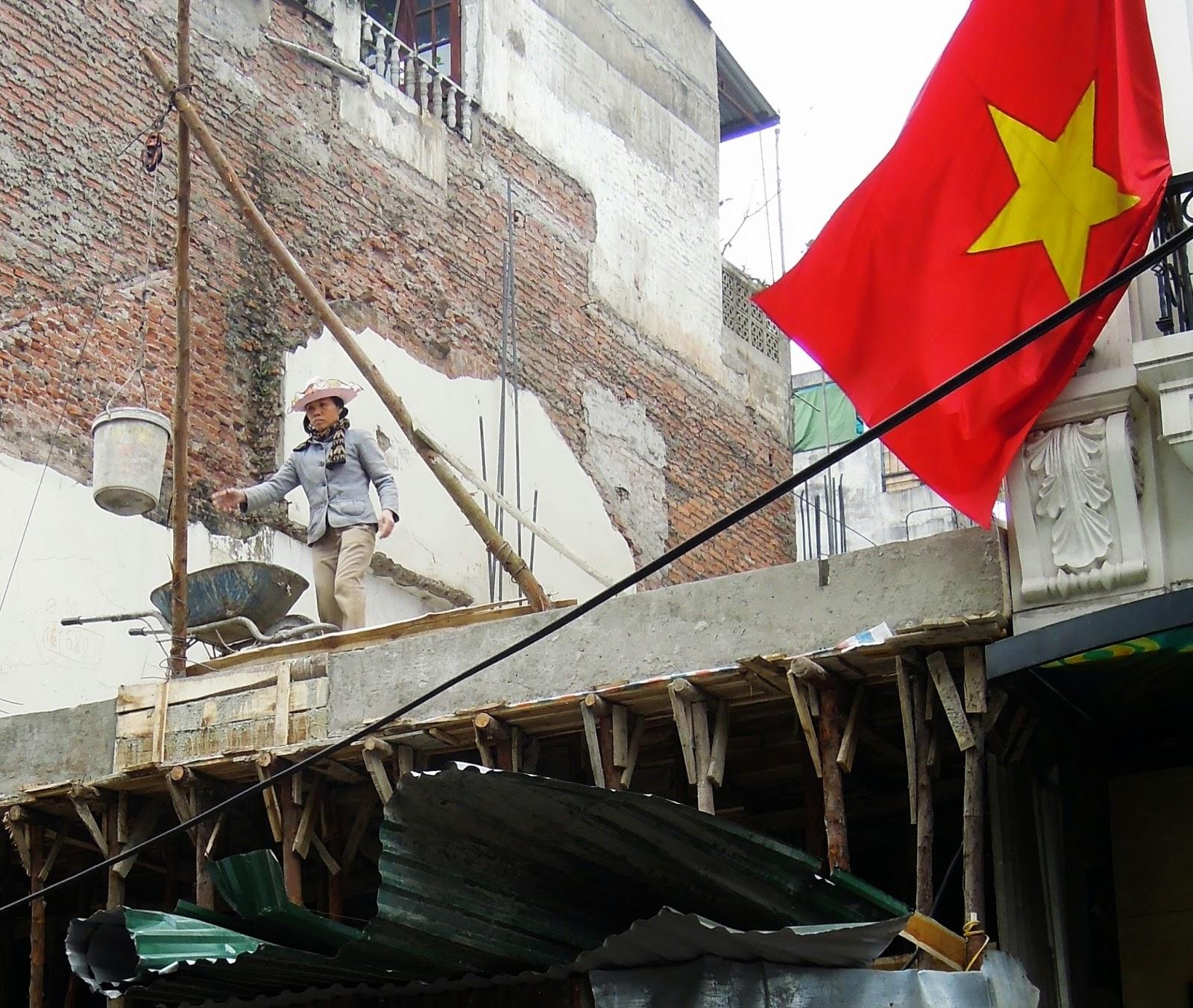 female construction worker, Hanoi