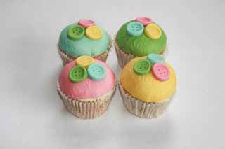 4 pastel button baby shower cupcakes