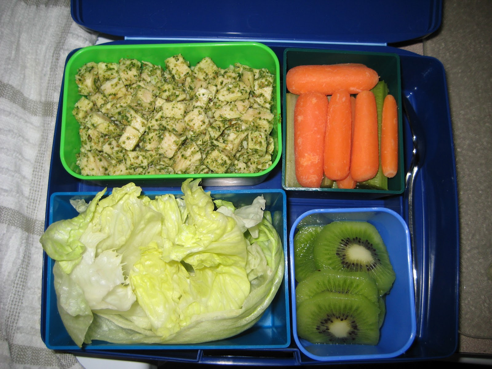 pesto chicken lettuce wraps with baby carrots, celery sticks and kiwi ...