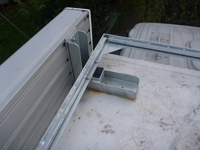 20mm box section rails welded to roof rack frame on which the decking boards sit