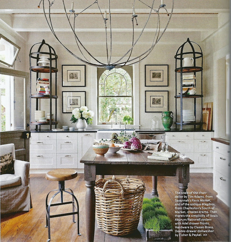 an antique farm table is gets a new life as a center island in this luxurious kitchen - Antique Farmhouse Kitchen Tables