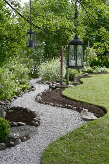 any snow a crushed stone or gravel pathway bordered by larger rocks