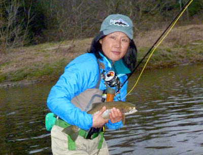 Flygirl Hyun Kounne with rainbow trout, east branch, delaware river, NY
