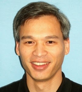 head shot photo of Fred Tchang smiling