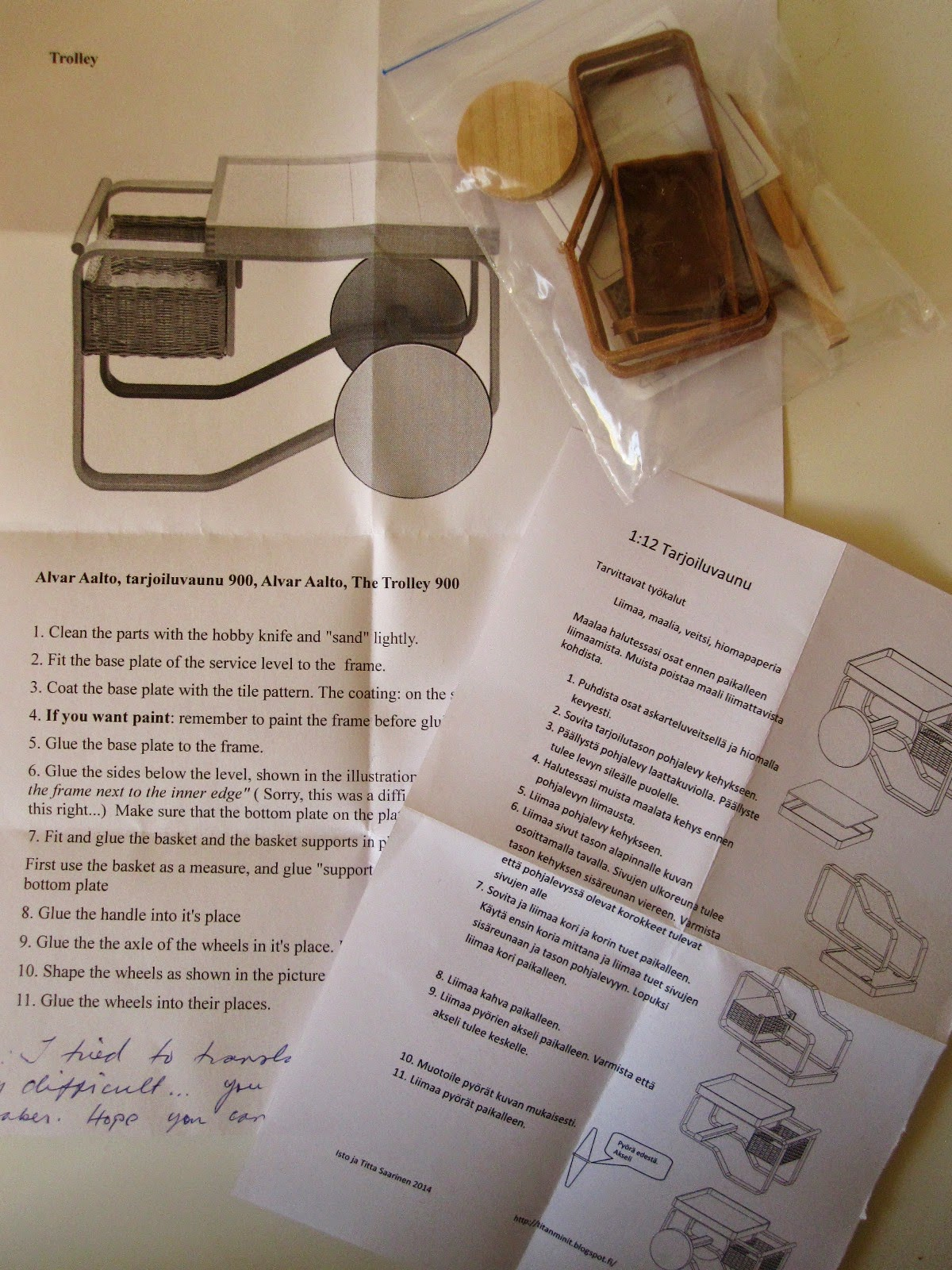 Pieces for a kitset miniature Aalto 900 trolley, plus instructions sheets in Finnish and English.