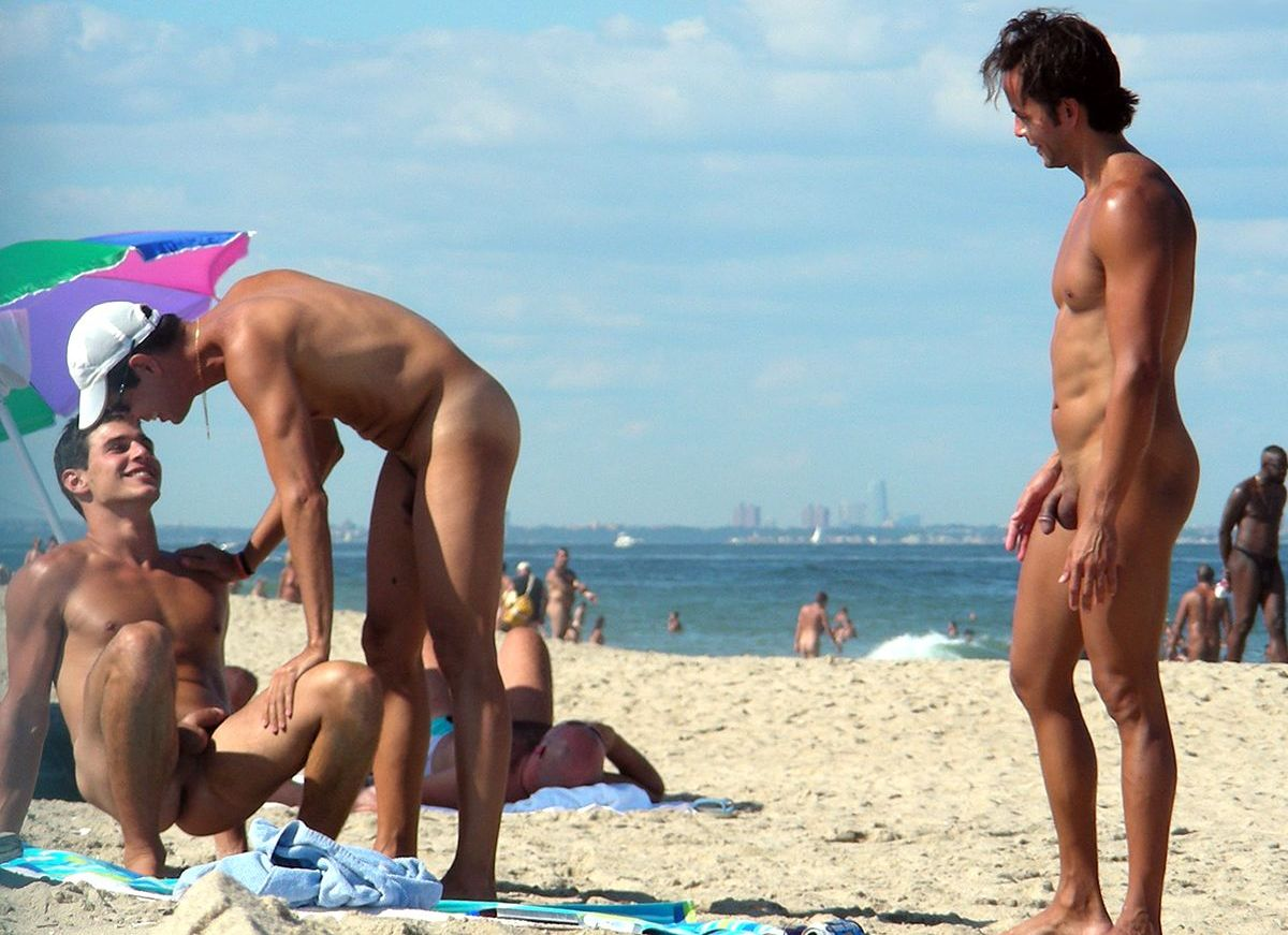 Nude men at beach party