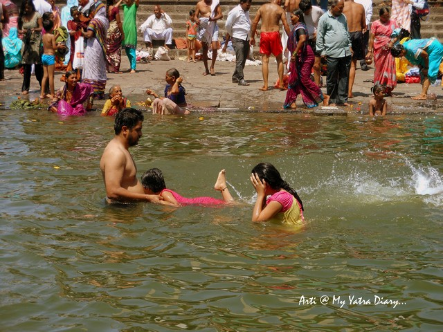 People bathing at Godavari River Ghat, Nashik