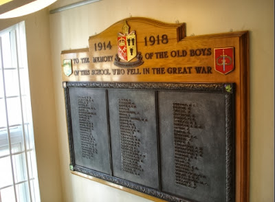 Three bronze coloured panels set on a wooden board.  Each panel has a long list of names, but they are too small to read and there is no transcription on the War Memorials Online website as yet.