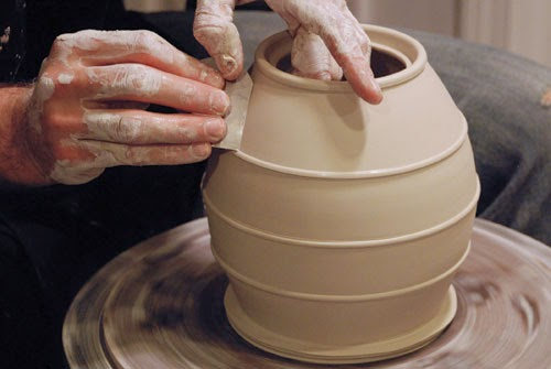 a potter making a vase