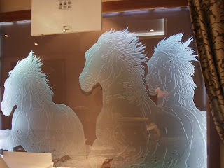 Etched window of horses, The Royal Horseguards Hotel, London