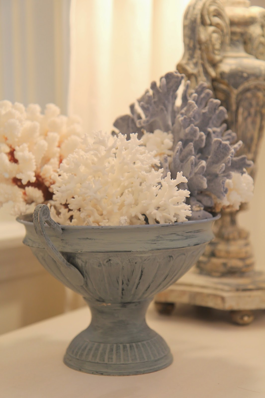 Painted blue urn with coral on side table; Transforming an Urn for Home Decor; Nora's Nest