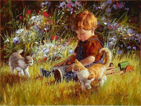 nene con gatos