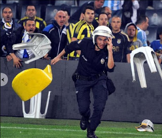 funny pictures with fans throwing chairs at police