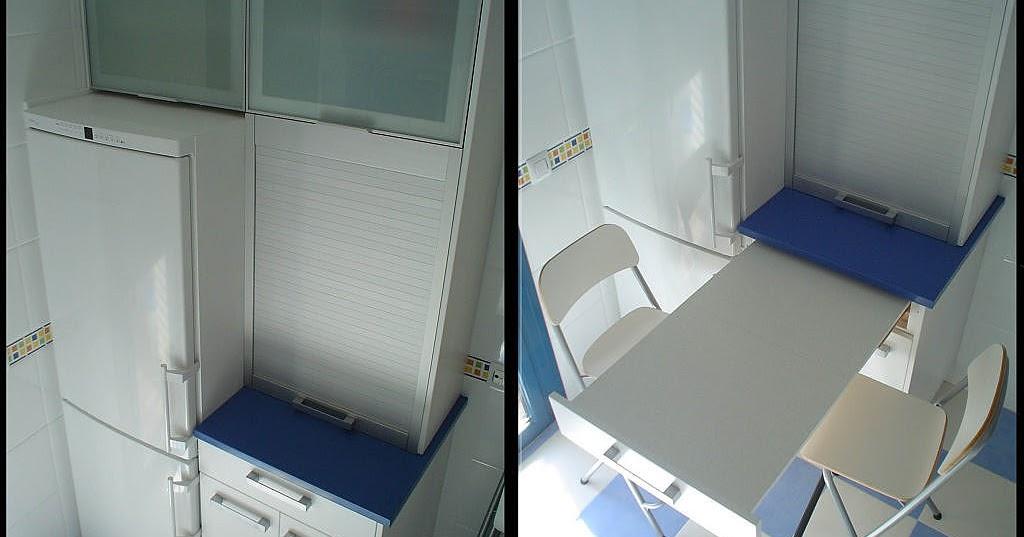 Cocinas armarios puertas parquet mesas extraibles for Barra extensible armario