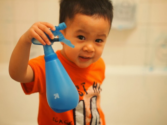 spray bottle filled with food coloring activity