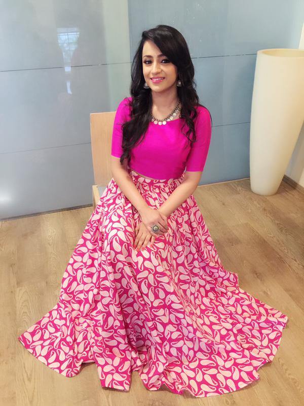 trisha in pink dress
