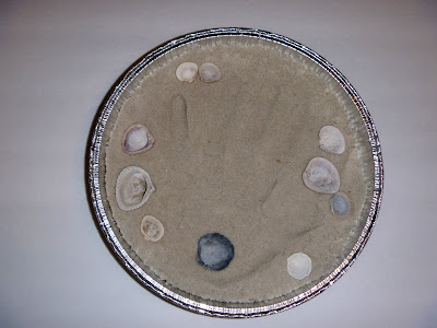 aluminum cake pan, plaster of paris, sand, sea shells, hand print art, shadow box