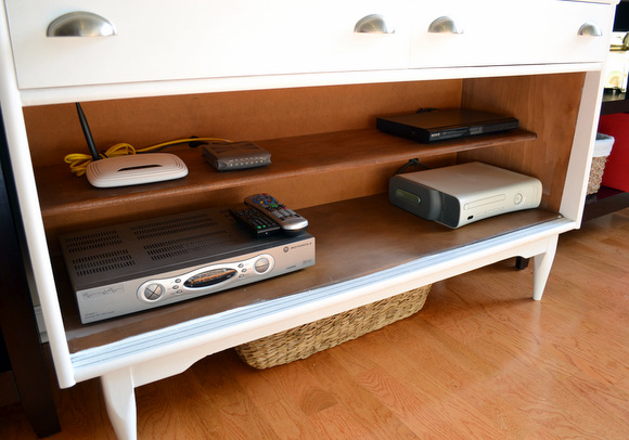 Here's the inside of our new media console. See how all of our electronics are neatly organized!