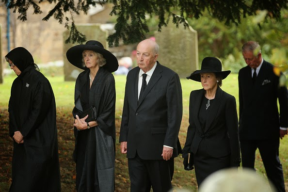 Prince Charles, Prince of Wales (R) follows the Duke and Duchess of Devonshire, Lady Sophia Cavendish (2ndR) and Lady Emma Cavendish (L) during the funeral of Deborah, Dowager Duchess of Devonshire makes it's way to St Peters Church, Edensor, past Chatsworth House on 02.10.2014 in Chatsworth, England.