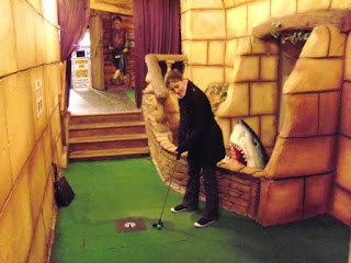 Emily at the indoor Magical Golf FX Adventure Golf course at Manning's Amusements in Felixstowe, Suffolk