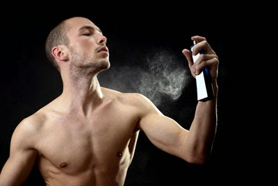 sexy men spray his perfume to his boby
